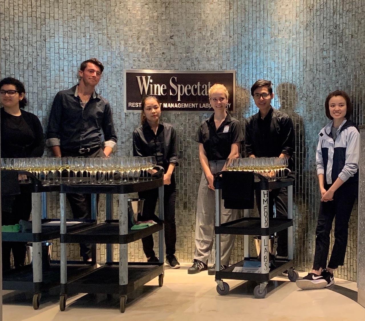 FIU School of Hospitality student volunteers dubbed Wine Angels