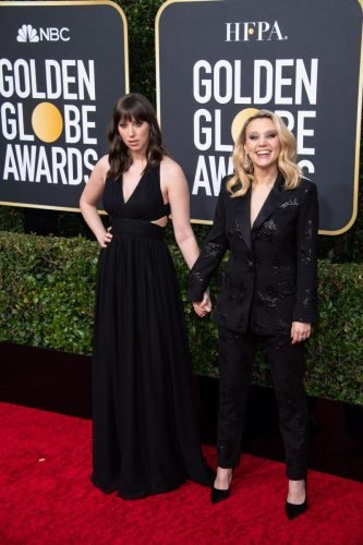 Kate McKinnon (L) and guest arrive at the 77th Annual Golden Globe Awards at the Beverly Hilton in Beverly Hills, CA on Sunday, January 5, 2020.