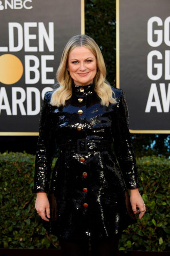 Amy Poehler arrives at the 78th Annual Golden Globe Awards at the Beverly Hilton in Beverly Hills, CA on Sunday, February 28, 2021.