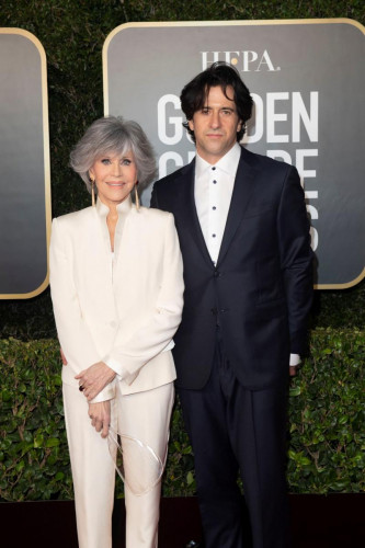 Jane Fonda and Troy Garity arrive at the 78th Annual Golden Globe Awards at the Beverly Hilton in Beverly Hills, CA on Sunday, February 28, 2021.