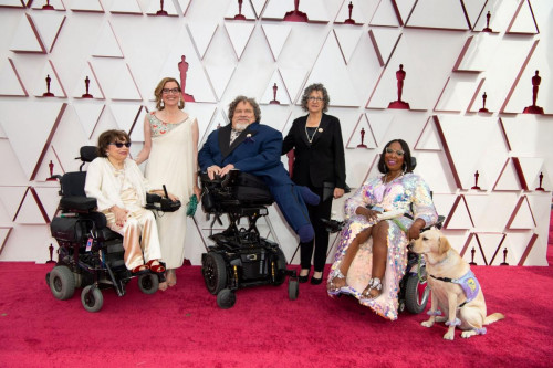 From left, Judith Heumann, Nicole Newnham, James LeBrecht, Sara Bolder, Andraea LaVant and service dog Gofi LaVant on the red carpet of The 93rd Oscars at Union Station in Los Angeles, CA on Sunday, April 25, 2021.