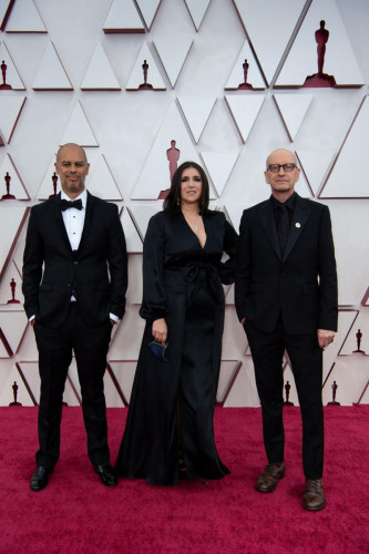 Jesse Collins, Stacy Sher, Steven Soderbergh arrive on the red carpet of The 93rd Oscars at Union Station in Los Angeles, CA on Sunday, April 25, 2021.