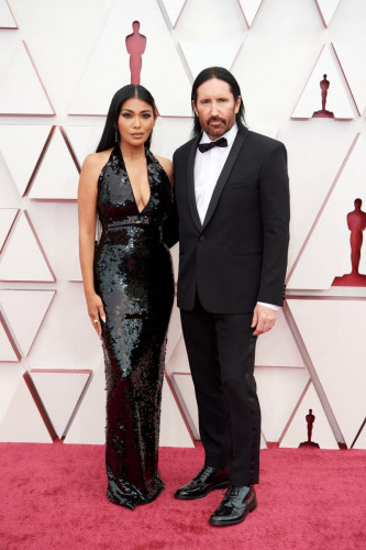 Mariqueen Maandig and Oscar nominee Trent Reznor arrive on the red carpet of The 93rd Oscars at Union Station in Los Angeles, CA on Sunday, April 25, 2021