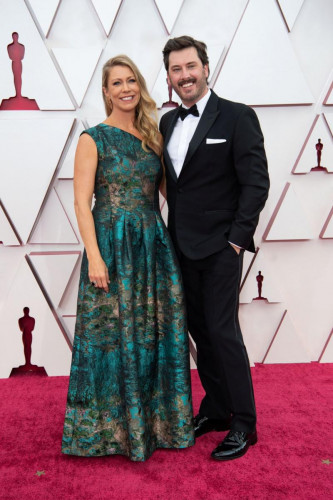 Oscar nominee Ben Browning (R) and guest arrive on the red carpet of The 93rd Oscars at Union Station in Los Angeles, CA on Sunday, April 25, 2021.