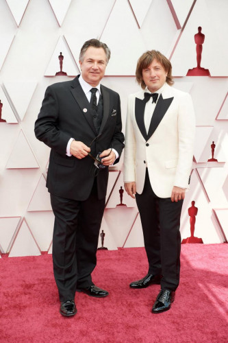 Oscar nominee Daniel Pemberton (R) and guest arrive on the red carpet of The 93rd Oscars at Union Station in Los Angeles, CA on Sunday, April 25, 2021.