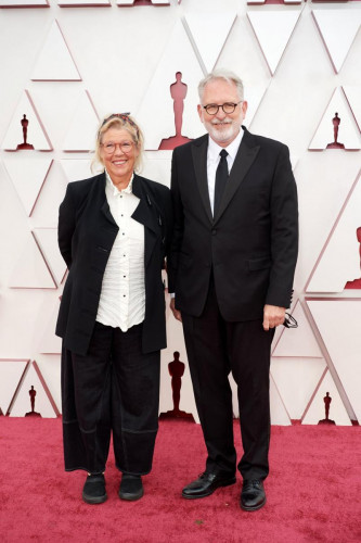Oscar nominee David Crank, right, and guest arrives on the red carpet of The 93rd Oscars at Union Station in Los Angeles, CA on Sunday, April 25, 2021.