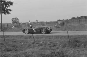 Phil Hill at the wheel of XKC 007 en route to victory at Elkhart Lake in September of 1952, the first race win for a C Type in the United States Courtesy of the REVS Institute preview