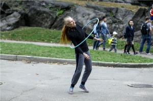 older lady in the park with hula hoop