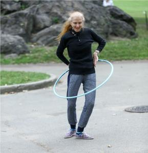 older lady in the park with hula hoop 2