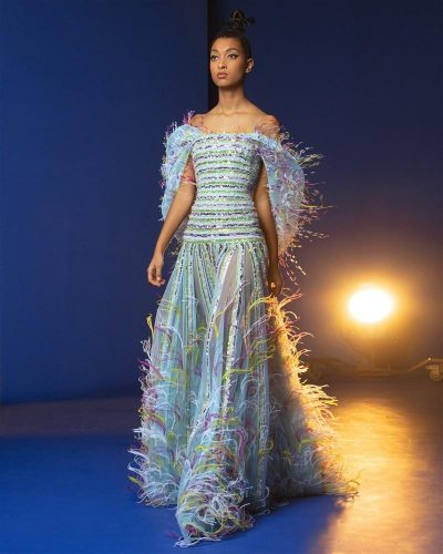 Turquoise Off-Shoulders Gown Embellished With Sequins Of Vibrant Colors, Ostrich Feathers, and Knitted Threading