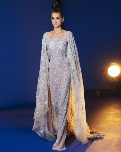 Silver Cape Gown Featuring A Floral Design Embroidered With Soft White Pearls And Beads