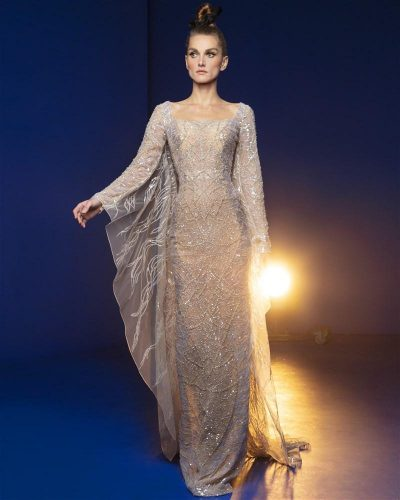 Royal Gold Gown Embroidered With Iridescent Sequins and Beads In Shades of Gold and Silver Featuring Long Cape Sleeves