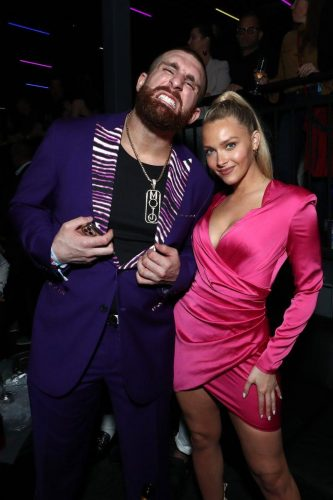 (L-R) Mojo Rawley and Camille Kostek attend AT&T TV Super Saturday Night at Meridian at Island Gardens on February 01, 2020 in Miami, Florida.