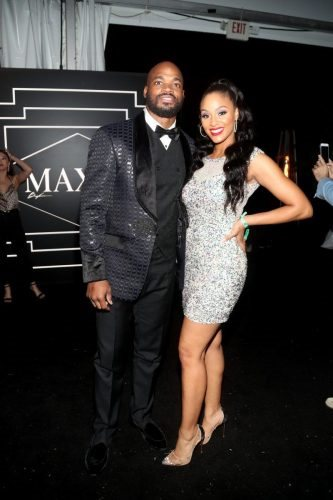 Adrian Peterson and Ashley Peterson pose for a photo during the 2020 MAXIM Big Game Experience on February 01, 2020 in Miami, Florida.