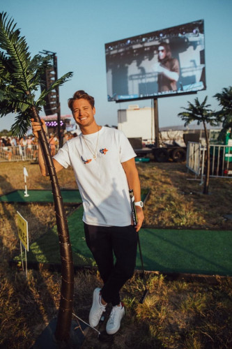 Kygo playing the PUMA Golf Chase Dreams Golf Experience