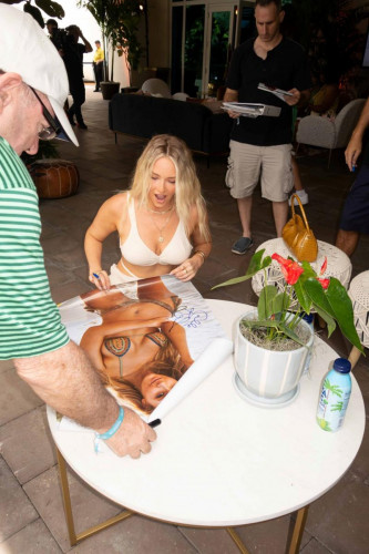 Camille Kostek signs autographs