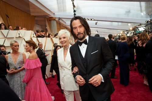 Patricia Taylor and Keanu Reeves arrives on the red carpet of The 92nd Oscars® at the Dolby® Theatre in Hollywood, CA on Sunday, February 9, 2020.