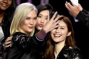 Victoria's Secret models Karlie Kloss, Ming Xi and Sui He pose during the All Model Appearance At Mercedes Benz Arena on November 18, 2017